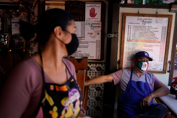 Restaurants and bars were hurt by job cuts in December amid tightened pandemic restrictions. A Mexican restaurant in Los Angeles.