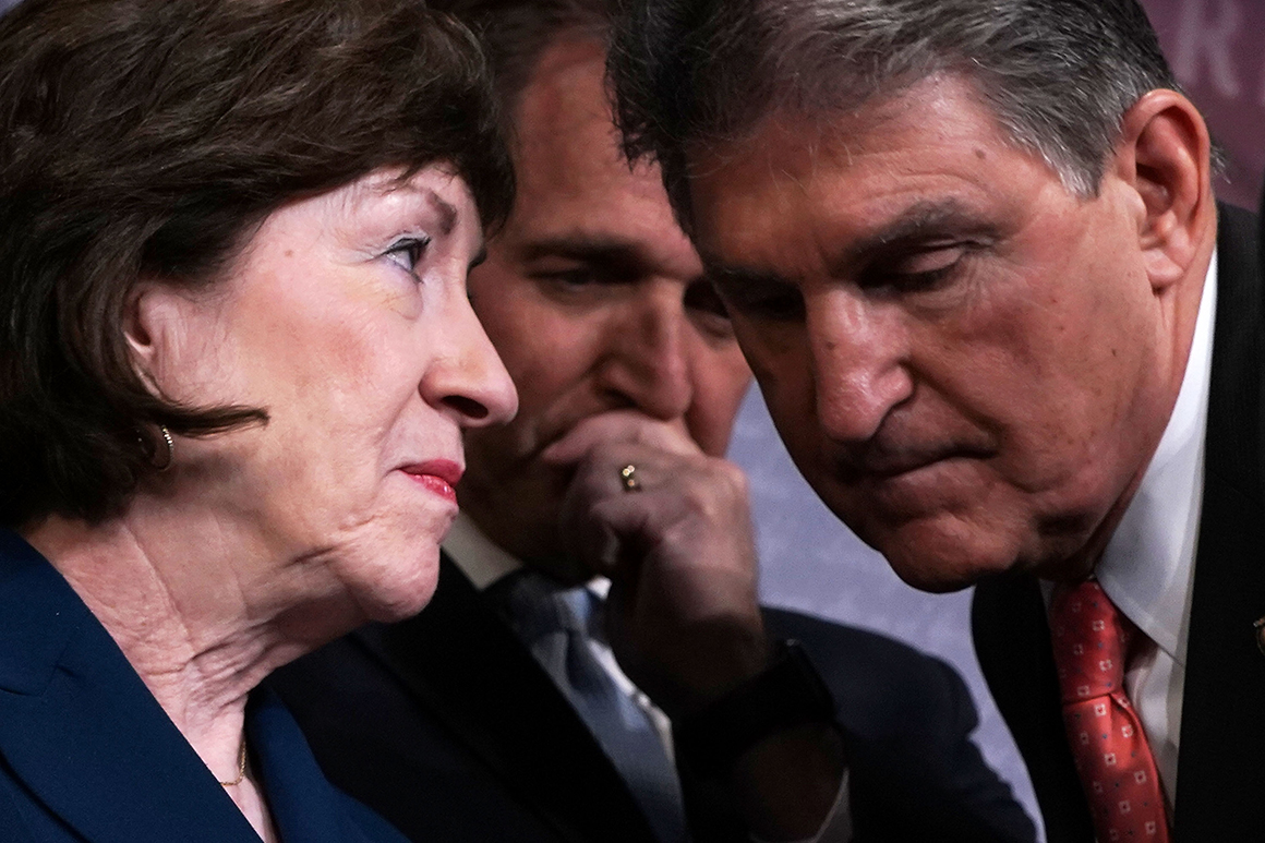 Sen. Susan Collins talks to Sen. Joe Manchin as Sen. Jeff Flake looks on during a news conference.