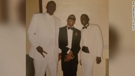 George Floyd, left, is pictured with Jonathan Veal and another friend.